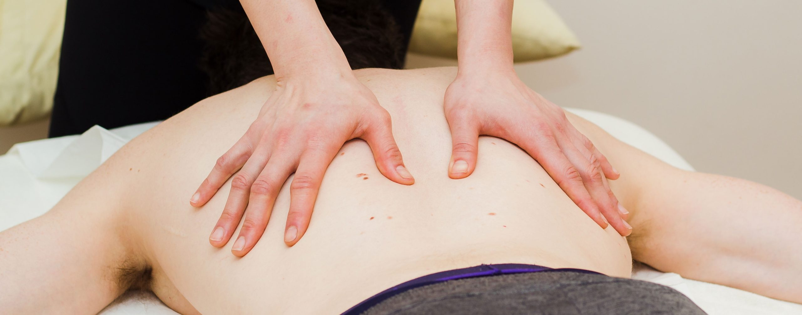 Image of Jackie's hands on an osteopathy patients' back